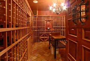 Mediterranean Wine Cellar with Standard height, terracotta tile floors, Chandelier, Built-in bookshelf, six panel door