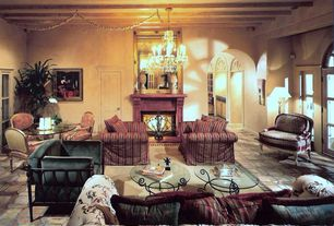 Traditional Living Room with Chandelier, six panel door, French doors, Fireplace, Cement fireplace, Transom window