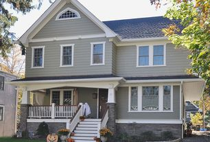Craftsman Exterior of Home with Crushed Rock & Driveway Gravel, Andersen Windows & Doors Tilt-Wash Double-Hung Windows