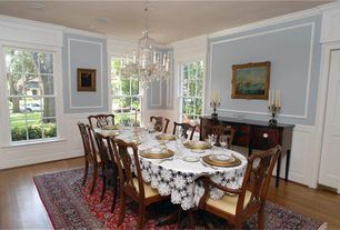 Traditional Dining Room with Wainscotting, Chandelier, Crown molding, Laminate floors