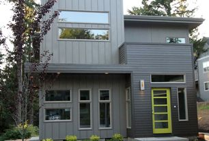 Modern Exterior of Home with Transom window, French doors, Pathway, exterior tile floors