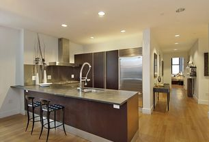 Contemporary Kitchen with Stainless Steel, High ceiling, Concrete counters, Breakfast bar, Destiny: slab cabinets, Flush