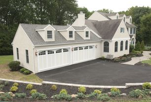 Traditional Garage with Arched windows, Carriage house garage doors, Dormer window, Carriage-style garage doors