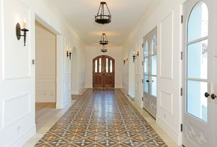 Eclectic Entryway with Wall sconce, Crown molding, Chandelier, French doors, travertine tile floors