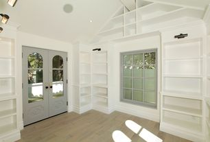 Traditional Library with Cavero laminate - 10mm seaside collection delray oak, Paint, Built in shelves, Vaulted ceiling