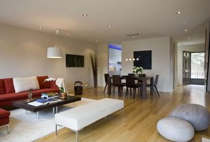 Contemporary Great Room with High ceiling, Pendant light, can lights, Laminate floors