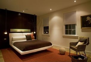 Contemporary Master Bedroom with Pendant light, double-hung window, can lights, Hardwood floors, Standard height