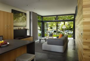 Modern Living Room with Standard height, Paint 1, Della Robbia Becca Sofa, can lights, French doors, Laminate floors