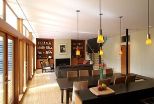 Contemporary Great Room with Laminate floors, French doors, Transom window, Built-in bookshelf, Pendant light, High ceiling