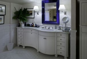 Cottage Master Bathroom with Wall sconce, Wall Tiles, Undermount sink, penny tile floors, Complex marble counters