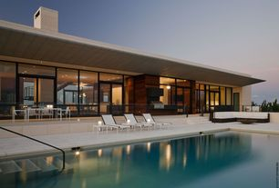 Contemporary Swimming Pool with Transom window, exterior tile floors, Accent exterior lighting, French doors