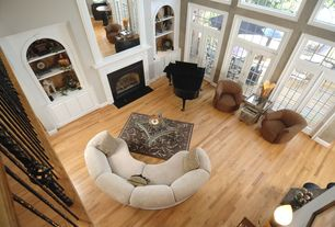 Contemporary Great Room with Transom window, Built-in bookshelf, French doors, Cement fireplace, Laminate floors