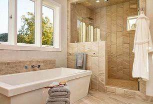 Contemporary Master Bathroom with Frameless shower door, Freestanding bathtub, Beige marble tile