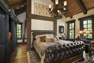Rustic Master Bedroom with Leather tufted sleigh bed, Exposed beam, Chandelier, Laminate floors, Cathedral ceiling