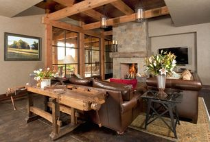 Craftsman Living Room with Black bear manufactured stone - hackett, Paint 1, Exposed beam ceiling, stone fireplace, Area rug