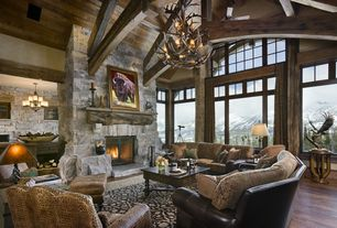 Rustic Great Room with Cathedral ceiling, stone fireplace, Exposed beam, Fireplace, picture window, Laminate floors, Columns