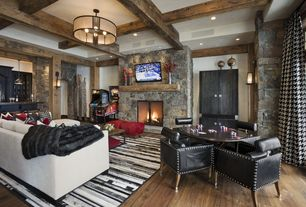 Contemporary Game Room with Laminate floors, Wall sconce, Exposed beam, High ceiling