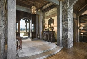 Rustic Entryway with Interior stacked stone wall, specialty door, slate floors, Exposed beam, Hardwood floors, Chandelier