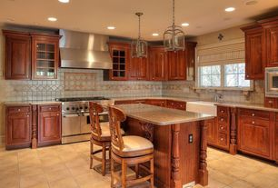 Mediterranean Kitchen with Pental bahia rio polished granite, braydon manor custom cabinets