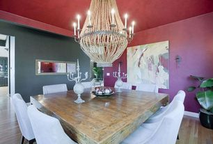 Modern Dining Room with Laminate floors, Wall sconce, Chandelier, Standard height