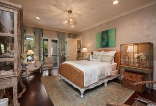 Traditional Guest Bedroom with can lights, Crown molding, Standard height, French doors, Casement, Hardwood floors, Balcony