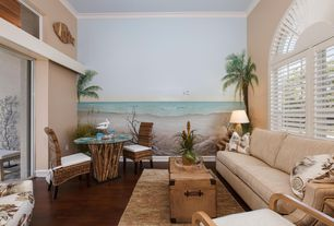 Tropical Living Room with Crown molding, Arched window, High ceiling, Laminate floors, specialty window, Mural