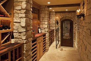 Traditional Wine Cellar with Built-in bookshelf, can lights, Wall sconce, slate floors, Exposed beam, Standard height