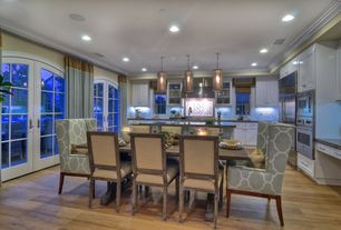 Contemporary Dining Room with Willoughby dining chair, Laminate floors, French doors, Crown molding