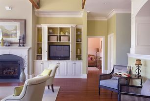 Traditional Living Room with Cement fireplace, Built-in bookshelf, Laminate floors, Crown molding