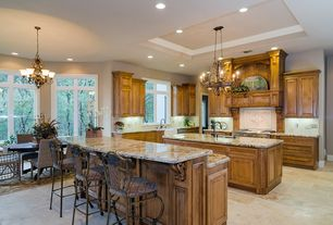 Traditional Kitchen with Complex granite counters, gas range, dishwasher, stone tile floors, Casement, Breakfast bar, Paint 1