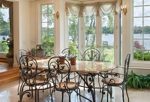 Traditional Dining Room with Wall sconce, High ceiling, sandstone tile floors, French doors