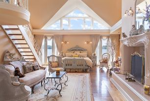Traditional Master Bedroom with Laminate floors, Carved fireplace mantle, Cement fireplace, Cathedral ceiling, French doors