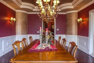 Traditional Dining Room with Wainscotting, Laminate floors, High ceiling, Crown molding, Wall sconce, Chandelier