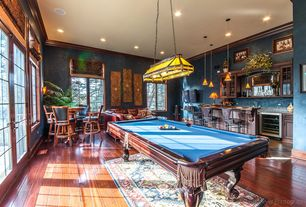 Traditional Game Room with Hardwood floors, Pendant light, Crown molding, French doors