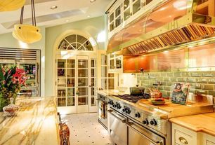 Eclectic Kitchen with True glass half-door reach-in refrigerator, Arched transom window, Pendant lights, can lights, Paint