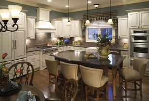 Country Kitchen with Kitchen island, Crown molding, Sea Gull Lighting The Gladstone 1 Light Mini Pendant, Custom hood