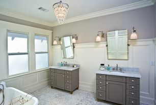 Traditional Master Bathroom with Wall sconce, Chair rail, Complex Marble, Complex marble counters, penny tile floors
