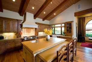 Country Kitchen with Breakfast bar, Glass panel, Custom hood, Kitchen island, Simple granite counters, Framed Partial Panel
