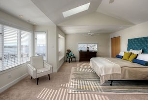 Contemporary Master Bedroom with Carpet, double-hung window, can lights, Ceiling fan, flat door, Skylight, Standard height