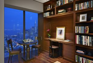 Modern Home Office with Laminate floors, High ceiling, Built-in bookshelf
