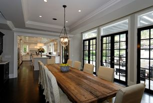 Traditional Dining Room with can lights, Crown molding, Hampton pendant, Transom window, Laminate floors, flush light, Paint