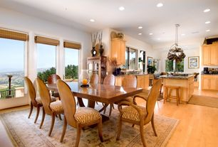 Eclectic Dining Room with can lights, Standard height, picture window, Chandelier, Laminate floors, Built-in bookshelf