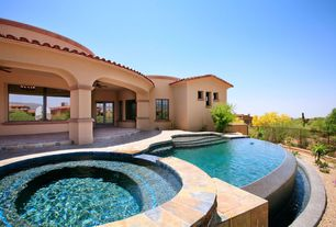 Contemporary Swimming Pool with French doors, Pool with hot tub, exterior stone floors, Fence