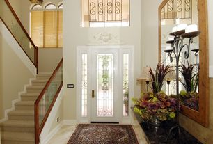 Traditional Entryway with terracotta tile floors, Wainscotting, Crown molding, Glass panel door, Carpet, High ceiling