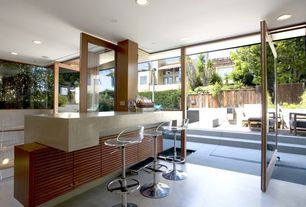 Contemporary Bar with specialty door, Standard height, picture window, Concrete floors, can lights