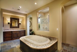 Mediterranean Master Bathroom with Raised panel, Wall sconce, frameless showerdoor, Undermount sink, Simple marble counters
