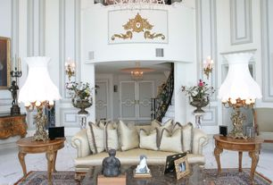 Traditional Living Room with Wall sconce, Chandelier, Columns, specialty door, Cathedral ceiling, stone tile floors, Loft