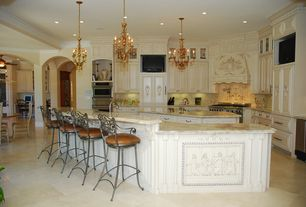 Traditional Kitchen with Custom hood, Complex marble counters, Undermount sink, full backsplash, L-shaped, Concrete floors