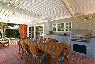 Modern Patio with exterior brick floors, specialty window, sliding glass door, Outdoor kitchen