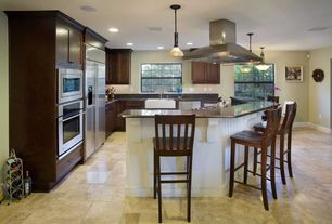 Traditional Kitchen with Built In Refrigerator, Standard height, Pendant light, can lights, Flat panel cabinets, Soapstone